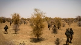 FILE - A photo taken on April 10, 2013 shows French soldiers taking part, 105 kms north of the northeastern Malian city of Gao, in an operation to find Islamist fighters.