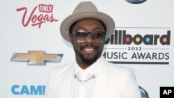 Will.i.am arrives at the Billboard Music Awards at the MGM Grand Garden Arena in Las Vegas, May 19, 2013.