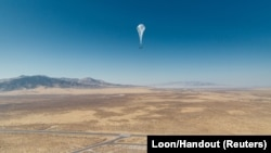 A Loon internet balloon, carrying solar-powered mobile networking equipment flies over the launch site in Winnemucca, Nevada, U.S., in June 27, 2019.