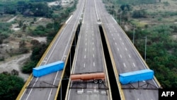 Aerial view of the Tienditas Bridge, along the border between Cucuta, Colombia, and Tachira, Venezuela, after Venezuelan military forces blocked it with containers, Feb. 6, 2019.