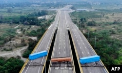 Aerial view of the Tienditas Bridge, on the border between Cucuta, Colombia and Tachira, Venezuela, after Venezuelan military forces blocked it with containers on February 6, 2019.