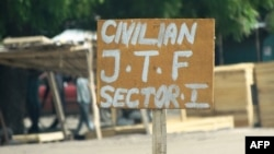 FILE - A sign near a checkpoint of a vigilante group reads Civilian J.T.F or Civilian Joint Task Force in Maiduguri, July 19, 2013. The group released 894 children Friday, according to the United Nations Children Fund.