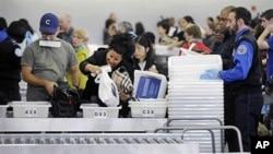 Travelers at John F. Kennedy International Airport in New York go through security screening, 22 Oct 2010