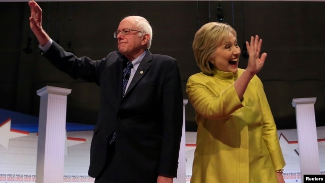 Democratic U.S. presidential candidates Senator Bernie Sanders and former Secretary of State Hillary Clinton arrive on stage ahead of the start of the PBS NewsHour Democratic presidential candidates debate in Milwaukee, Wisconsin, Feb. 11, 2016.