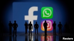 Facebook, Whatsapp and Instagram logos are displayed in this illustration taken October 4, 2021.
