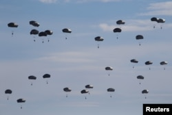 FILE - U.S. paratroopers from the 82nd Airborne Division based in Fort Bragg, N.C., participate in a massive airdrop as part of the NATO Exercise Trident Juncture 2015 at the San Gregorio training grounds outside Zaragoza, Spain, Nov. 4, 2015.