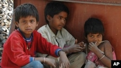 Thousands of additional children are on the streets of New Delhi as their parents toil to build Commonwealth Games venues and related infrastructure