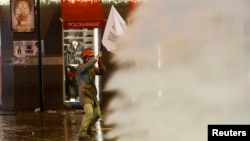 Turkish riot police use water cannons to disperse demonstrators during an anti-government protest in central Istanbul, Dec.27, 2013.