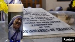 An image of Mother Teresa is seen on a candle used on Teresa's tomb during a special mass service in Kolkata, India, Dec. 18, 2015.