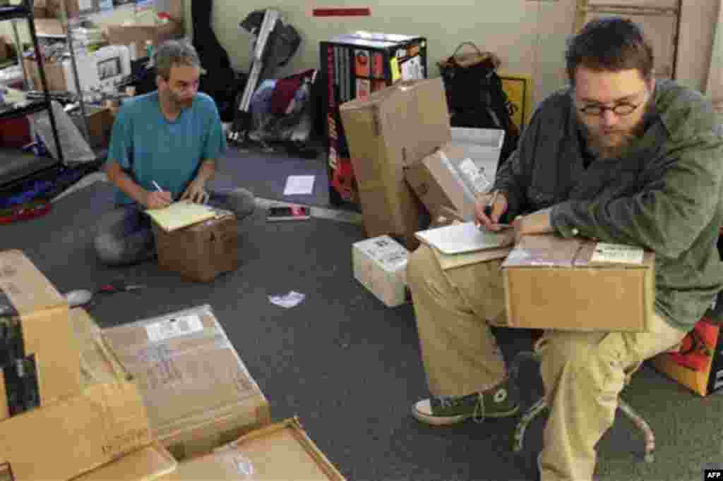 In a photo taken Wednesday, Oct. 26, 2011, Occupy Wall Street protesters open packages sent to the protesters in New York. Since the protests began on Sept. 17, protesters at the Zuccotti Park encampment say they�ve received about 100 letters a day. (AP P