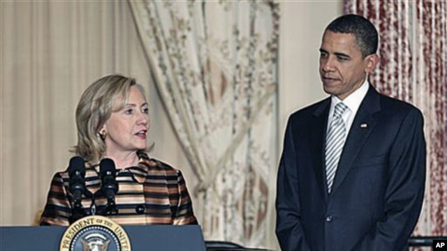 President Barack Obama is introduced by Secretary of State Hillary Rodham Clinton at a holiday reception for international diplomats at the State Department in Washington, where they praised the work of the late Amb. Richard Holbrooke, Dec 13, 2010