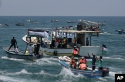 Two Palestinian fishing boats are sailing with 20 people, including medical patients and students who were unable to leave overland passages in Gaza City on May 29, 2018.