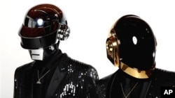 Thomas Bangalter, left, and Guy-Manuel de Homem-Christo, from the group Daft Punk pose for a portrait on Wednesday, April 17, 2013 in Los Angeles.