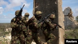 Kenya Defence Forces Rangers, who are part of the African Mission in Somalia (AMISOM), secure an area during a foot patrol on the outskirts of the controlled area of the old airport in the coastal town of Kismayu in southern Somalia, Nov. 12, 2013.
