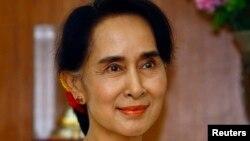 ທ່ານນາງ Aung San Suu Kyi ຜູ້ນຳພັກສັນນິບາດແຫ່ງຊາດ ເພື່ອປະຊາທິປະໄຕ ໃນມຽນມາ ວັນທີ 13 ມິຖຸນາ 2014.