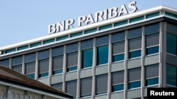 FILE - A BNP Paribas sign is displayed on a building of the bank in Geneva, July 1, 2014.