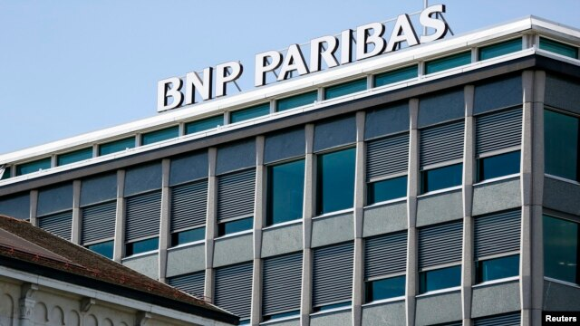 FILE - A BNP Paribas sign is pictured on a building of the bank in Geneva, July 1, 2014.