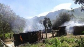 Smoke rises from homes in the village of Chukudum after a rampage by soldiers on Tuesday, Oct. 7, 2014, claimed at least three lives.