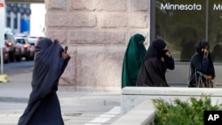 FILE - Female members of Minnesota's Somali community are seen arriving at the Federal Court building in St. Paul, Minnesota, April 23, 2015.