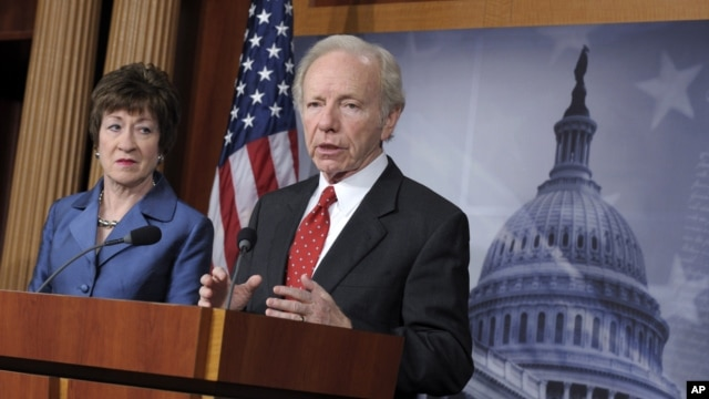 Senate Homeland Security Committee Chairman Sen. Joseph Lieberman, I-Conn., right, speaks during a news conference on Capitol Hill in Washington, December 31, 2012, to discuss the committee's report on the security deficiencies at the temporary U.S. Missi
