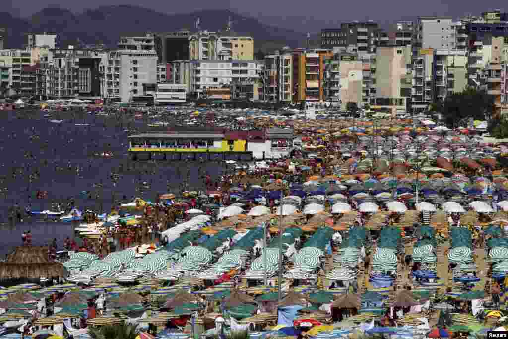 A general view of the crowded beach in the city of Durres, August 13, 2014. Albania has been gripped by hot weather, with temperatures reaching 38°C (100°F).