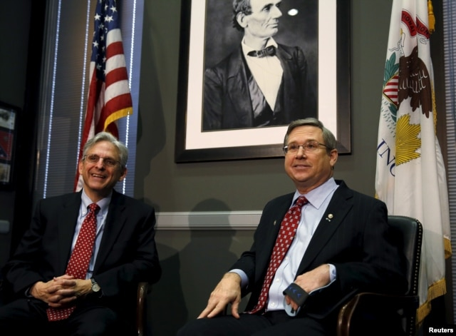 U.S. Senator Mark Kirk, an Illinois Republican, meets with President Barack Obama's Supreme Court nominee Merrick Garland, at left, on Capitol Hill in Washington, March 29, 2016.