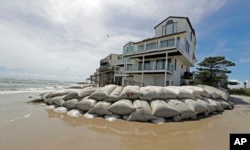 Sandbags surround homes on North Topsail Beach, N.C., Sept. 12, 2018, as Hurricane Florence threatens the coast.