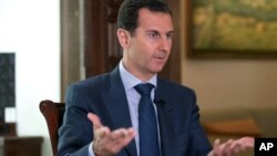 Сирийский президент Башар Асад дает интервью агентству Associated Press