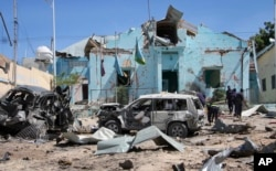 FILE - Somali security forces attend the scene of a car bomb attack in Mogadishu, Somalia, June 20, 2017.