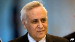 FILE - In this Nov. 10, 2011 file photo, Former Israeli President Moshe Katsav arrives at the Supreme court, in Jerusalem. His request for a conditional early release from prison has been rejected by a parole board.
