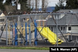 A playground at Lowell Elementary School in Tacoma, Washington sits empty after school closed because of the coronavirus. Parents are deciding how to talk with their children about the virus.