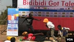 Members of a drama act perform a play depicting domestic violence at the Bidibidi Got Talent show in Yumbe Uganda, Dec. 16, 2017. (H. Athumani/VOA)