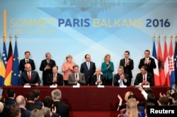 FILE - Leaders from the European Union and Balkan states meet during a western Balkans summit in Paris, July 4, 2016.