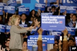FILE - Democratic presidential candidate Hillary Clinton, left, greets Rep. Judy Chu of California before addressing Asian-American and Pacific Islander supporters in San Gabriel, Calif., Jan. 7, 2016.