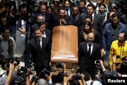 People carry the coffin of the opposition lawmaker Fernando Alban during a ceremony at the National Assembly in Caracas, Venezuela, Oct. 9, 2018.