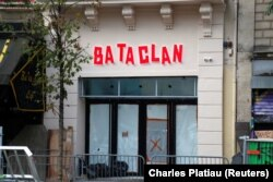 FILE - The new facade of the Bataclan concert hall is seen after months of renovations at the site almost one year after a series of attacks at several sites in Paris, France, France, Oct. 27, 2016.