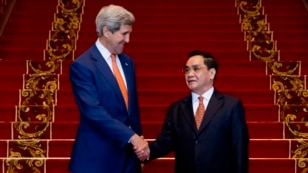 U.S. Secretary of State John Kerry, left, shakes hands with Lao Prime Minister Thongsing Thammavong after their meeting at the Prime Minister's Office in Vientiane, Laos, Monday, Jan. 25, 2016.