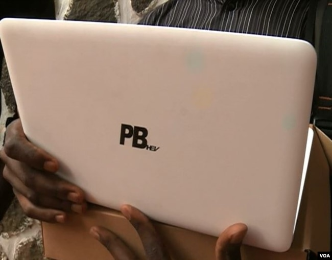 One of 500,000 laptops Cameroon's government says it hopes to distribute to university students by April of 2018. All of the computers bear the letters PB HEV, short for Paul Biya, Higher Education Vision. (M. Kindzeka/VOA)