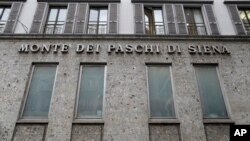 The facade of a branch of the ' Monte Dei Paschi di Siena ' bank in Milan, Italy, Dec. 19, 2016.