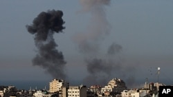Smoke rises from an explosion following an Israeli airstrike in Gaza City, March 10, 2012.