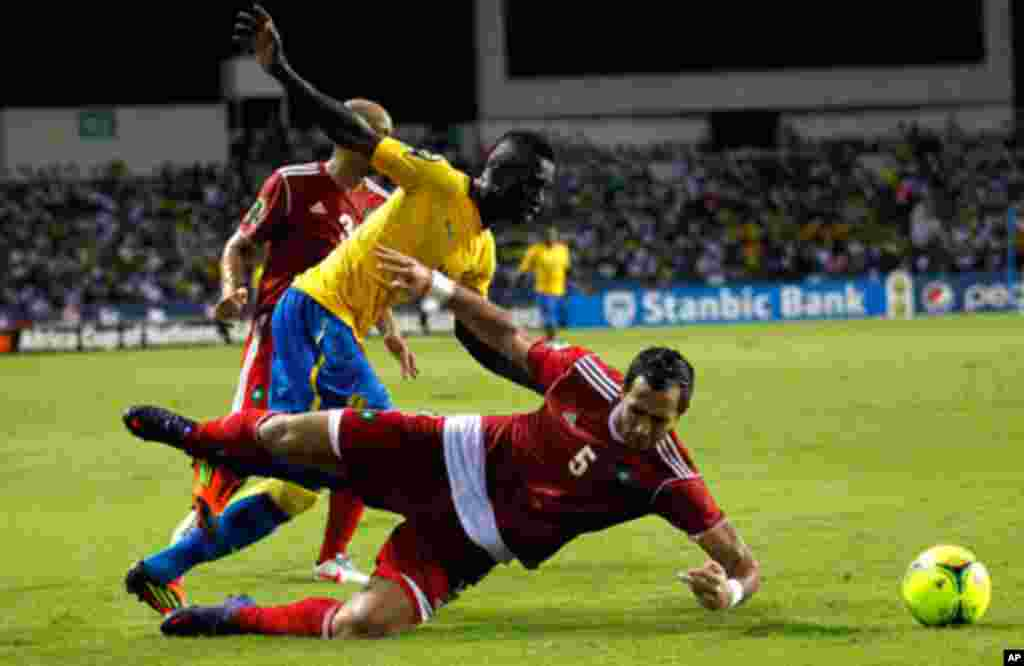 Morocco's Amine is tackled by Gabon's Mouloungui during their African Cup of Nations soccer match in Libreville