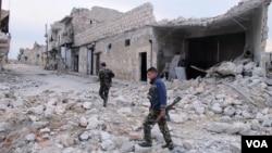 Nhà cửa đổ nát trên một con đường ở Aleppo