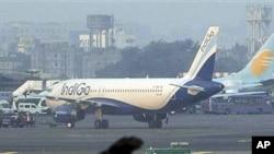 An IndiGo aircraft stands parked at Chhatrapati Shivaji airport in Mumbai, India, January 12, 2011