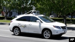 FILE - A Google self-driving car goes on a test drive near the Computer History Museum in Mountain View, Calif, May 14, 2014.