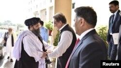 دیدار قریشی با ملا عبدالغنی برادر در اسلامآباد