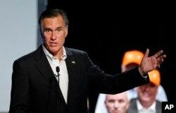 Former Republican presidential nominee Mitt Romney introduces Republican U.S. Rep. Mia Love, of Utah, during a campaign rally, Aug. 24, 2018, in Lehi, Utah.