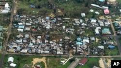 Rumah-rumah di Port Vila, Vanuatu hancur pasca hantaman topan Pam, 16 Maret 2015 (Foto: AP Photo/Dave Hunt, Pool)