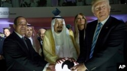 FILE - In this May 21, 2017 photo, Egyptian President Abdel Fattah al-Sissi, Saudi King Salman, U.S. First Lady Melania Trump and President Donald Trump, visit a new Global Center for Combating Extremist Ideology, in Riyadh, Saudi Arabia.
