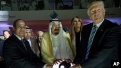 FILE - In this May 21, 2017 photo released by the Saudi Press Agency, from left to right, Egyptian President Abdel Fattah al-Sissi, Saudi King Salman, U.S. First Lady Melania Trump and President Donald Trump, visit a new Global Center for Combating Extrem