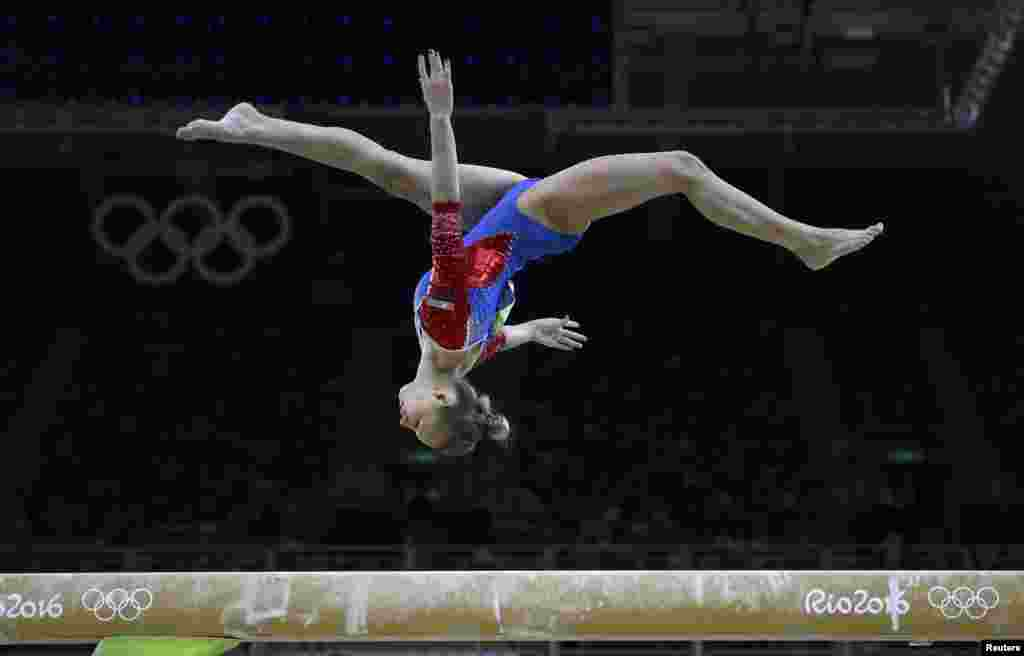Daria Spiridonova of Russia competes on the balance beam during the women's qualifications.